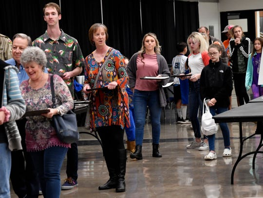 Attendees line up for the Chili Day and Auction sponsored by the Greater Kiwanis Club of Abilene.