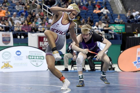Swain CountyÕs Jonas Trejo wrestles Chatham CharterÕs Chandler Steel in the 1A 126-pound state title match at the NCHSAA state championship wrestling tournament at the Greensboro Coliseum in Greensboro on Feb. 22, 2020.