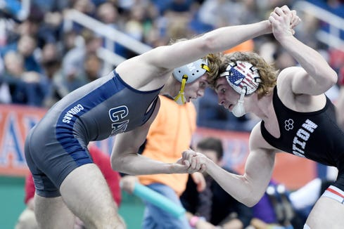 PisgahÕs Braden Riggs wrestles Central AcademyÕs Hunter Ross in the 3A 126-pound state title match at the NCHSAA state championship wrestling tournament at the Greensboro Coliseum in Greensboro on Feb. 22, 2020.