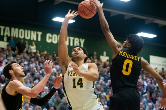 UMBC's Keondre Kennedy (0) blocks the shot by Vermont's Isaiah Powell (14) during the men's basketball game between the UMBC Retrievers and the Vermont Catamounts at Patrick Gym on Saturday night February 22, 2020 in Burlington, Vermont.