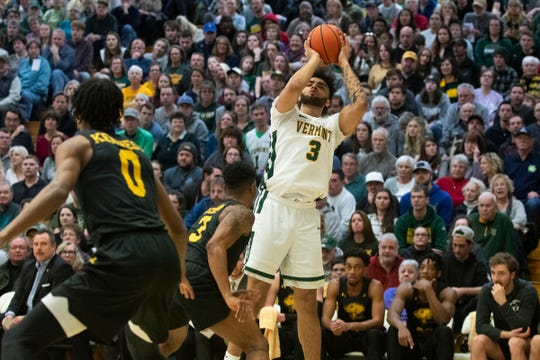 Vermont's Anthony Lamb (3) shoots a three pointer during the men's basketball game between the UMBC Retrievers and the Vermont Catamounts at Patrick Gym on Saturday night February 22, 2020 in Burlington, Vermont.