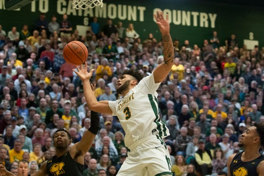 Vermont's Anthony Lamb (3) is fouled as he leaps for a layup during the men's basketball game between the UMBC Retrievers and the Vermont Catamounts at Patrick Gym on Saturday night February 22, 2020 in Burlington, Vermont.