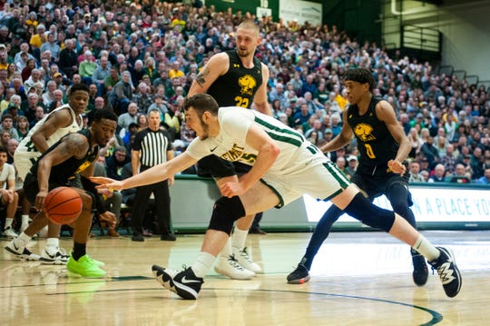 Vermont's Ryan Davis (35) dives for the loose ball during the men's basketball game between the UMBC Retrievers and the Vermont Catamounts at Patrick Gym on Saturday night February 22, 2020 in Burlington, Vermont.