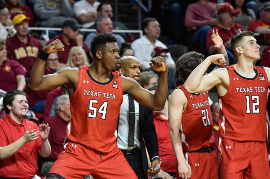 Feb 22, 2020; Ames, Iowa, USA; Texas Tech Red Raiders center Russel Tchewa (54) and forward Andrei Savrasov (12) react during the second half against the Iowa State Cyclones at Hilton Coliseum. Mandatory Credit: Jeffrey Becker-USA TODAY Sports