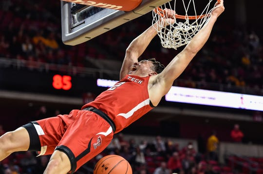 Feb 22, 2020; Ames, Iowa, USA; Texas Tech Red Raiders guard Clarence Nadolny (2) completes a slam dunk near the end of the 2nd half against the Iowa State Cyclones at Hilton Coliseum. Mandatory Credit: Jeffrey Becker-USA TODAY Sports