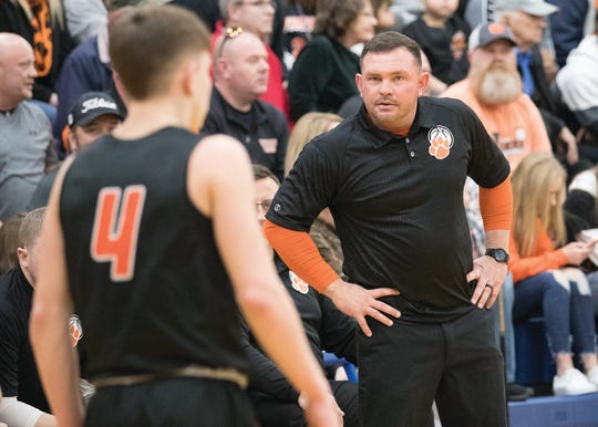Waverly head coach Travis Robertson looks at son Trey Robertson during a 38-34 sectional final win over Unioto at Southeastern High School on Saturday Feb. 22, 2020.