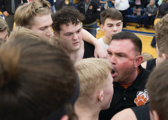 Waverly head coach Travis Robertson talks to team after a 38-34 win over Unioto in a Division II Sectional Final on Saturday Feb. 22, 2020 at Southeastern High School in Chillicothe, Ohio.