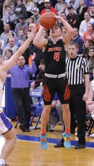 Waverly's Trey Robertson shoots a three-pointer during a 38-34 sectional final win over Unioto at Southeastern High School on Saturday Feb. 22, 2020.