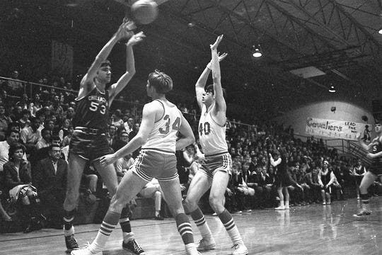 Cavaliers center Jim Johnson (53) gets a clean shot off in the Class AA sectional at Paint Valley. Johnson scored 30 points as the Cavaliers defeated the Thornville-Sheridan 66-52. Photo from February 1970.