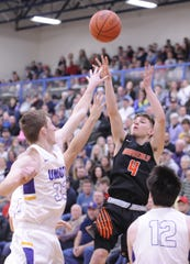 Waverly's Trey Robertson shoots a jumper during a 38-34 win over Unioto in a Division II Sectional Final on Saturday Feb. 22, 2020 at Southeastern High School in Chillicothe, Ohio.