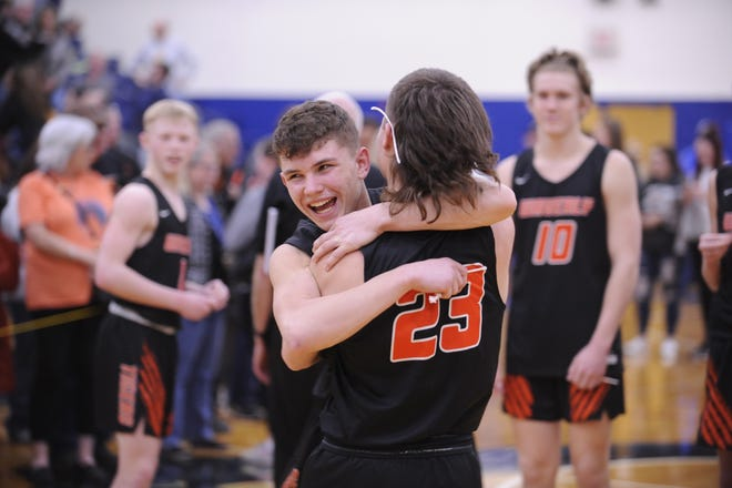 Waverly's Trey Robertson hugs teammate Michael Goodman after a 38-34 win over Unioto in a Division II Sectional Final on Saturday Feb. 22, 2020 at Southeastern High School in Chillicothe, Ohio.