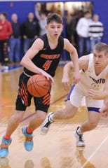 Waverly's Trey Robertson dribbles the ball during a 38-34 sectional final win over Unioto at Southeastern High School on Saturday Feb. 22, 2020.