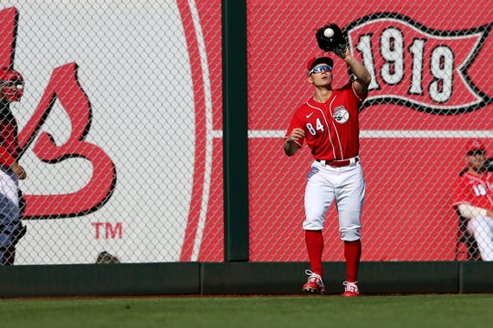 Cincinnati Reds non-roster invitee outfielder Stuart Fairchild (84) catches a fly ball in the seventh inning during a Cactus League spring training baseball game, Sunday, Feb. 23, 2020, at Goodyear Ballpark in Goodyear, Ariz.