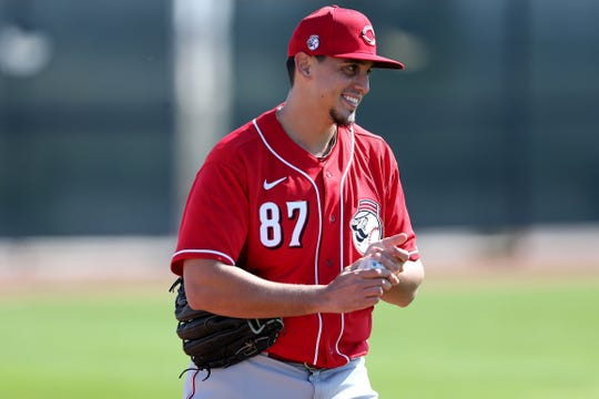 Cincinnati Reds pitcher Jose De Leon (87) smiles after talking with a fan during spring practice, Saturday, Feb. 15, 2020, at the Cincinnati Reds Spring Training Facility in Goodyear, Arizona.