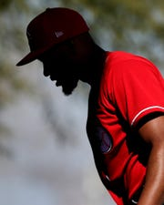 Cincinnati Reds relief pitcher Amir Garrett (50) walks up the the mound in the bullpen during spring practice, Monday, Feb. 17, 2020, at the baseball team's spring training facility in Goodyear, Ariz.