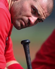 Cincinnati Reds first baseman Joey Votto (19) lifts his head off his bat during live batting practice, Sunday, Feb. 23, 2020, at the baseball team's spring training facility in Goodyear, Ariz.