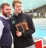 Mason's Adam Chaney was presented with the performer of the meet plague at the state swimming and diving championships in Canton Ohio, Saturday, Feb. 22, 2020.