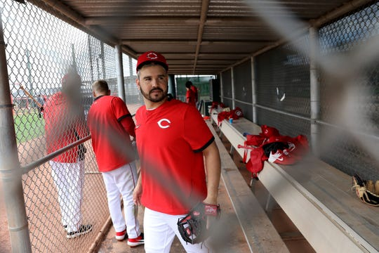 Cincinnati Reds third baseman Eugenio Suarez (7) walks out of the dugout during spring practice, Sunday, Feb. 23, 2020, at the baseball team's spring training facility in Goodyear, Ariz.