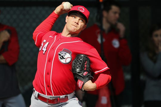 Cincinnati Reds starting pitcher Sonny Gray (54) delivers in the bullpen during spring practice, Sunday, Feb. 16, 2020, at the Cincinnati Reds Spring Training Facility in Goodyear, Arizona.