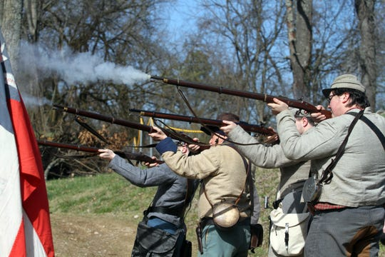 Jacob Waller, Dennis Bagwell, Matthew Waller and Tyler Steppee fire muskets during the Surrender of Fort Defiance commemoration event in Clarksville, Tenn., on Saturday, Feb. 22, 2020.