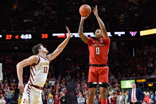 Feb 22, 2020; Ames, Iowa, USA; Texas Tech Red Raiders guard Kyler Edwards (0) shoots the ball over Iowa State Cyclones forward Michael Jacobson (12) during the first half at Hilton Coliseum. Mandatory Credit: Jeffrey Becker-USA TODAY Sports