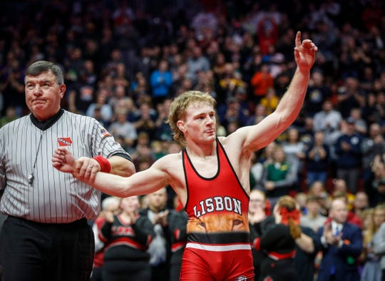 Lisbon senior Cael Happel reacts after pinning Underwood senior Logan James in their match at 138 pounds during the 2020 Iowa high school state wrestling tournament finals at Wells Fargo Arena in Des Moines on Saturday, Feb. 22, 2020. The win made Happel a 4-time state champion.