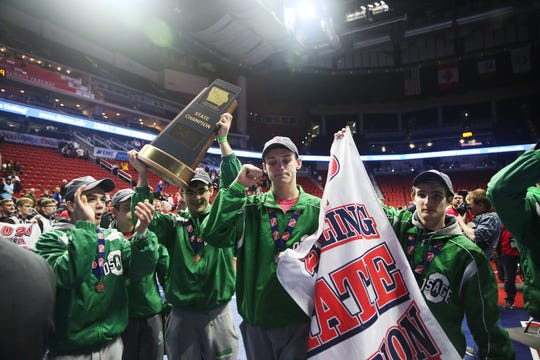 Osage wrestlers celebrate winning the team title at the conclusion of the Iowa high school state wrestling tournament on Saturday, Feb. 22, 2020, at Wells Fargo Arena, in Des Moines.