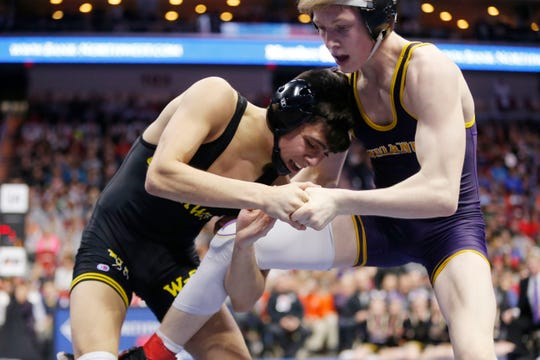 Ryder Downey of Indianola wrestles Bailey Roybal of Waverly-Shell Rock during the 113 pound class 3A championship match during the Iowa high school state wrestling tournament at Wells Fargo Arena Saturday, Feb. 22, 2020.