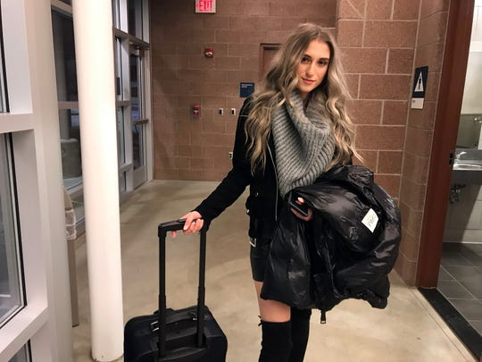 University of Michigan computer-science major Shelby Wilson of Birmingham awaits a ride home at the Amtrak station in Troy after arriving more than two hours late on New Year's Eve. Wilson said she relies on Amtrak and is accustomed to its unreliable schedules.