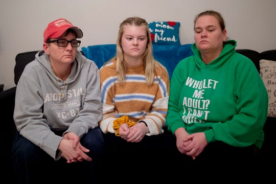 Christine Jackson, left, and Angela McDermitt-Jackson , right, sit with their daughter Destiney McDermitt at their home in Montrose, Mich., Feb. 13, 2020.