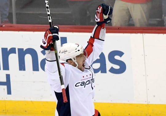 Washington Capitals left wing Alex Ovechkin (8) celebrates his 700th career goal during the third period Saturday.