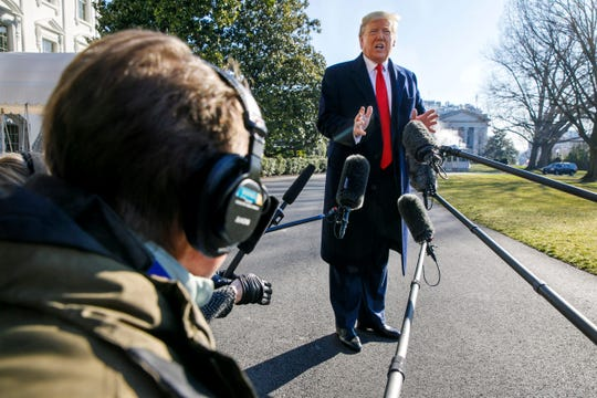President Donald Trump speaks to the media as he leaves the White House, Sunday, Feb. 23, 2020, in Washington, en route to India. (AP Photo/Jacquelyn Martin)