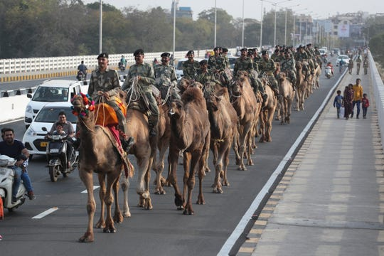 Border Security Force soldiers march Friday on the route that U.S. President Donald Trump will travel in Ahmadabad, India.