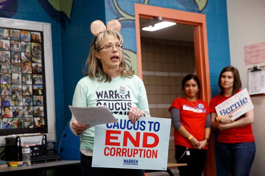 A supporter of Democratic presidential candidate Sen. Elizabeth Warren, D-Mass., speaks in support of her at a caucus location at Coronado High School in Henderson, Nev., Saturday, Feb. 22, 2020.