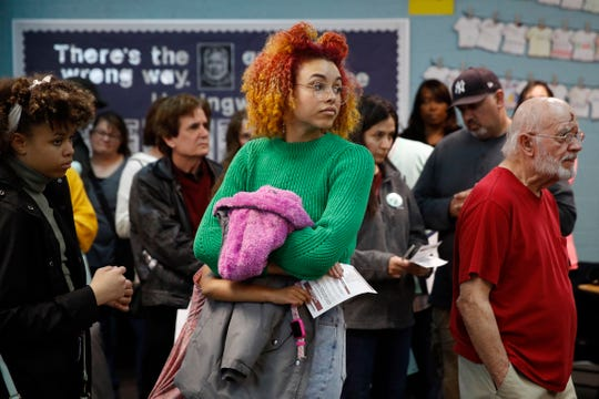 Caucus-goers gather at a caucus location at Coronado High School in Henderson, Nev., Saturday, Feb. 22, 2020.