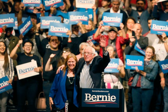 Democratic presidential candidate Sen. Bernie Sanders, I-Vt., with his wife Jane O'Meara Sanders, waves his hand during a rally in El Paso, Texas, Saturday, Feb. 22, 2020.