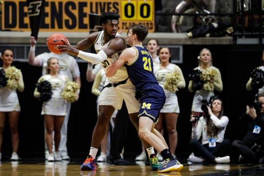 Michigan's Franz Wagner clamps down on Purdue's Trevion Williams on Saturday.