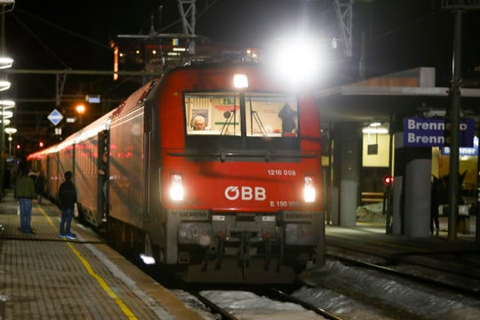A train stoped by authorities stands on the tracks at the train statin on the Italian side of the Brenner Pass, Italy, Sunday, Feb. 23, 2020. Austria halted all train traffic to and from Italy following fears that a train on Sunday night had two people on board who may have been infected with the COVID-19 virus. (AP Photo/Matthias Schrader3