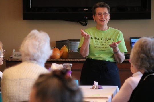 "Linda Lambert, of Bella Cuisine in Fremont, discusses herbal tea gardens at Schedel Garden's ""Spring Fever"" symposium on Saturday."