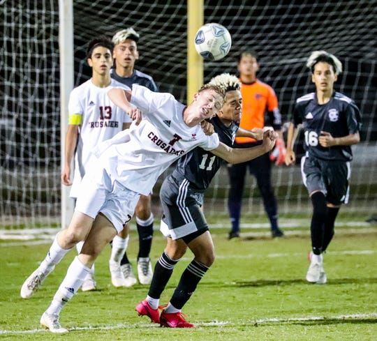 Sean Paul Negron battles Bishop Kenny player, Aidan Lipovetsky, for the ball. The Mariner boys soccer team played Bishop Kenny for a spot in the 4A state championship match. The Tritons look to make their first trip to a title match ever in the program's second Final Four.