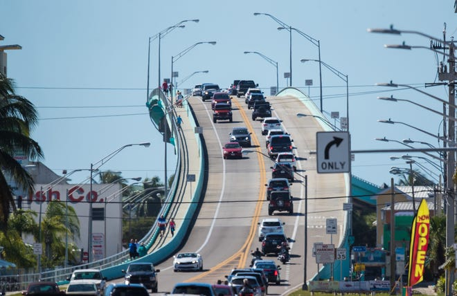 A line of traffic moves over the Matanzas Pass Bridge on Sunday Feb. 23, 2020.