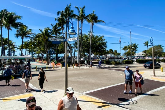Traffic and pedestrians use the intersection of Estero Boulevard and Old Estero Boulevard on Fort Myers Beach on Sunday Feb. 23, 2020.