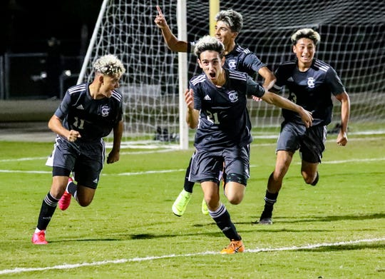 Jason Arias celebrates his goal with his teammates. The Mariner boys soccer team played Bishop Kenny for a spot in the 4A state championship match. The Tritons look to make their first trip to a title match ever in the program's second Final Four.