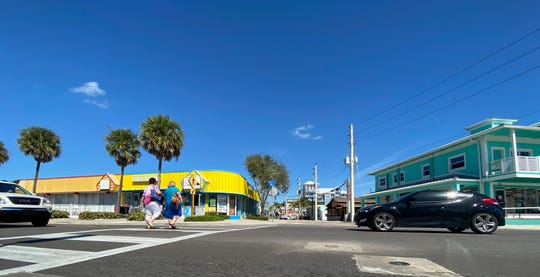 Traffic and pedestrians use the intersection of Estero Boulevard and Crescent Street on Fort Myers Beach on Sunday Feb. 23, 2020.