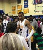 Wren forward Bryce McGowens greets fans after scoring 65 points in the Hurricanes' 103-78 win over Travelers Rest in the second round of the Class AAAA playoffs Saturday, February 22, 2020.