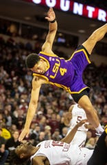 Feb 22, 2020; Columbia, South Carolina, USA; LSU Tigers guard Skylar Mays (4) falls after driving into South Carolina Gamecocks forward Wildens Leveque (15) in the second half at Colonial Life Arena. Mandatory Credit: Jeff Blake-USA TODAY Sports