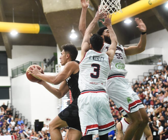 New Zealand dominated Guam 113-94 in the FIBA Asia Cup 2021 Qualifiers at the University of Guam Calvo Field House Feb. 23. The Guam men's national basketball team still has five games remainingfor a chance to advance to the FIBA Asia Cup 2021.
