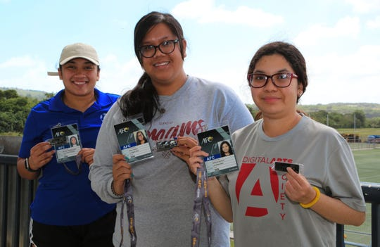 From left: Guam's Erlissa Delfin, Andee Tydingco and Samantha Bautista with their new 2020 AFC badges at the Guam Football Association National Training Center.