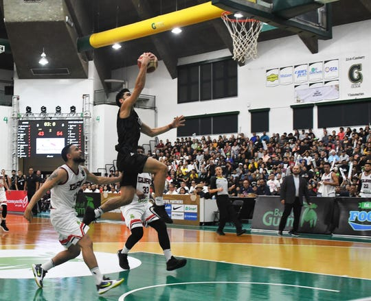 New Zealand guard No. 5 Shea Ili scores on a fast break against Guam during their FIBA Asia Cup 2021 Qualifier game Feb. 23 at the UOG Calvo Field House. The Tall Blacks defeated the Bank of Guam Men's Basketball team 113-94.