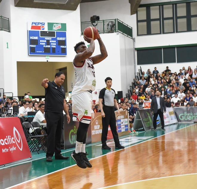 Guam's Earnest Lee Ross, Jr. shoots a 3-pointer against New Zealand in the FIBA Asia Cup 2021 Qualifiers at the University of Guam Calvo Field House in this Feb. 23 file photo. The Guam Basketball Confederation has been selected to the FIBA PLUS Strategy and Planning Program.